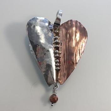 Heart Armor: talisman to assist in overcoming adversity